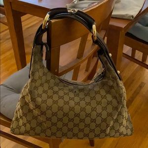 Very well loved Gucci bag.